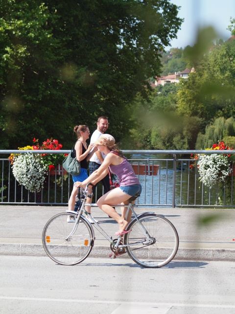 A man ogles a girl on a bicycle